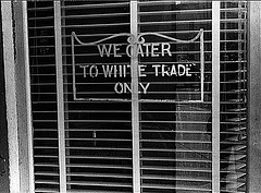 """We cater to white trade only"" restaurant sign"